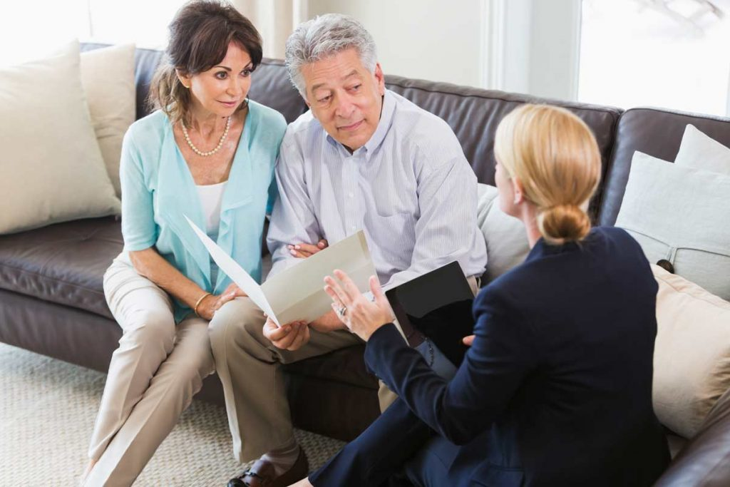 Couple talking with their financial adviser
